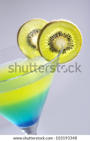 Closeup of a cocktail with fresh kiwi - stock photo
