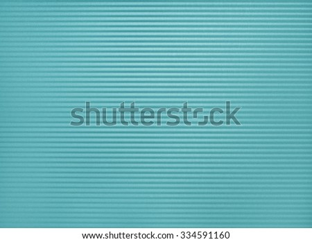 Closeup of a Colorful Cyan, Corrugated Metal Baking Pan for a Shaded Lines Background Template with blank room or space for your words, text, copy or design.  Horizontal