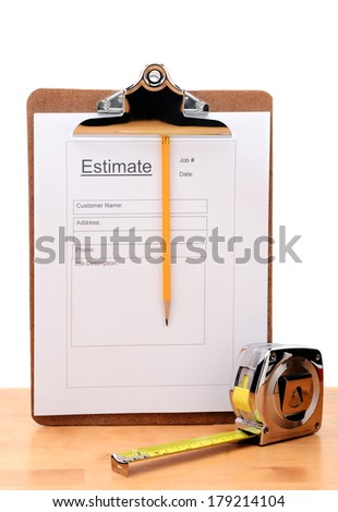 Closeup of a Contractors estimate form with a pencil and tape measure on a wooden table. Vertical on a white background. - stock photo