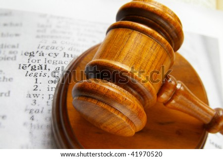 closeup of a court gavel and legal definition - stock photo