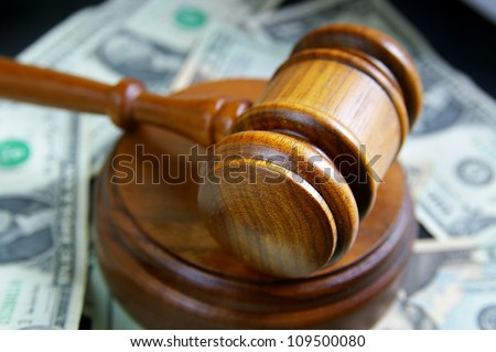 closeup of a court gavel on cash - stock photo