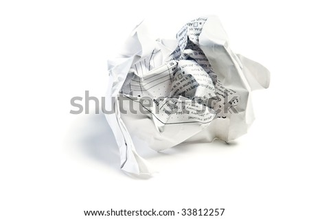 Closeup of a crumpled paper isolated on white background - stock photo