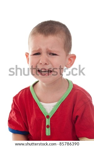 Closeup of a crying boy, studio shot, isolated on white - stock photo