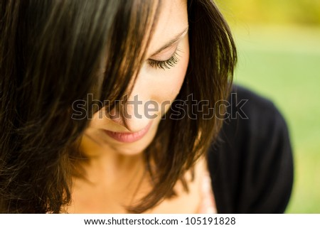 closeup of a cute woman - stock photo