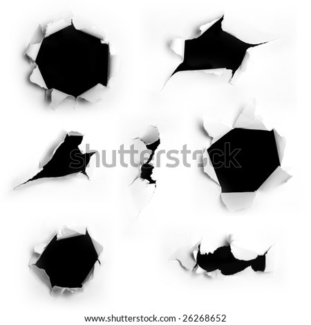 Closeup of a dark holes on white paper set - stock photo