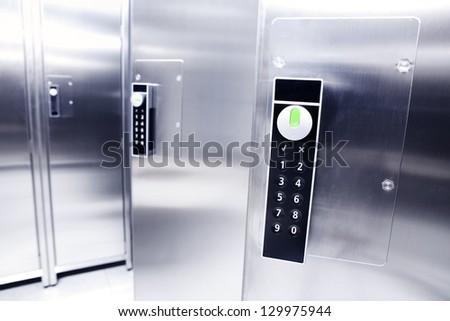Closeup of a digital padlock in a modern locker room - stock photo