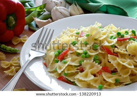 Closeup of a dish of bow-tie pasta