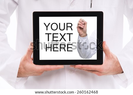 Closeup of a doctor holding a tablet computer with male doctor hand inside, writing something in the air with pen. - stock photo