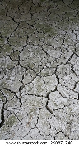 Closeup of a dry sandy soil at paddy field - stock photo