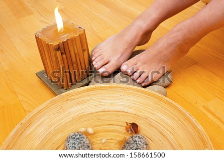 Closeup of a female feet at spa salon on pedicure - stock photo