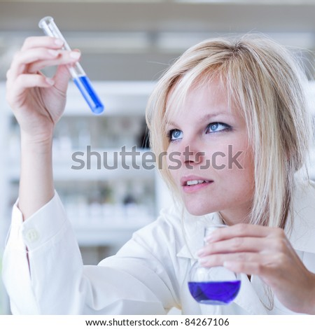Closeup of a female researcher carrying out experiments in a lab