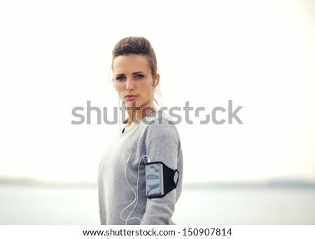 Closeup of a female runner serious about running - stock photo