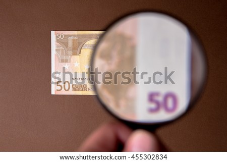Closeup of a Fifty Euro Note Through a Magnifying Glass  - stock photo