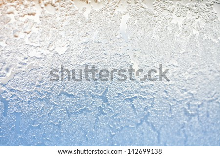 closeup of a frosted window pane - stock photo