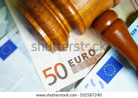 Closeup of a gavel and Euro notes - stock photo