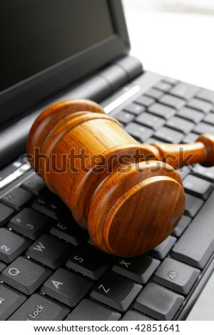 closeup of a gavel on a computer - stock photo