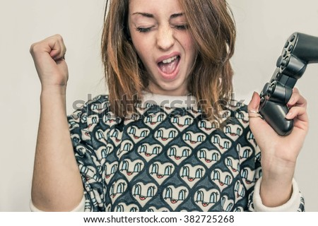 closeup of a girl who rejoices after winning a video game,isolated on White background - lifestyle, technology and people concept - stock photo