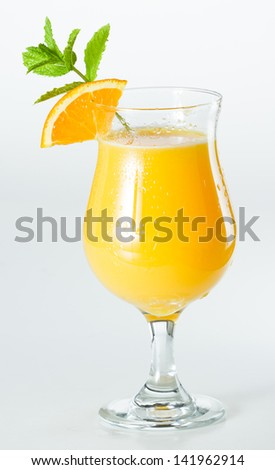 closeup of a glass filled with fresh orange juice isolated on a white background - stock photo