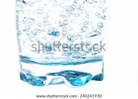 Closeup of a glass of fresh water with bubbles - stock photo