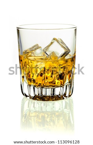 Closeup of a glass of golden whiskey on ice on a white background with reflection