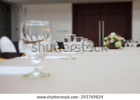Closeup of a glass on table in business meeting room - stock photo