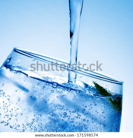 closeup of a glass with gin and tonic - stock photo