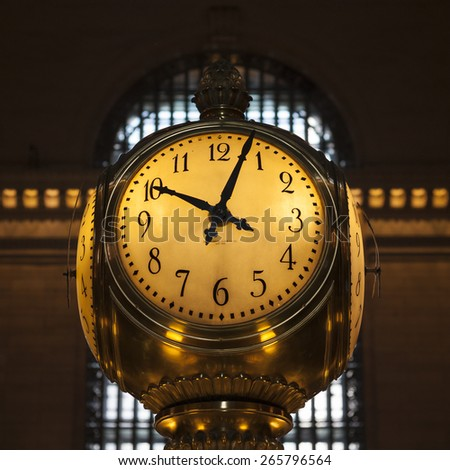 Closeup of a gold analog clock at grand central station - February 20 2015,  Manhattan, New York city, USA - stock photo