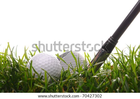 Closeup of a Golf Ball and Iron in tall grass with a white background. - stock photo