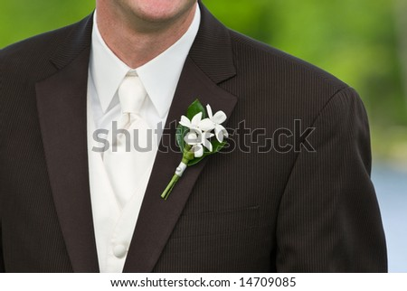 closeup of a groom's boutonniere