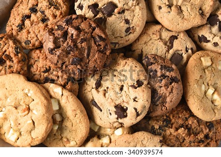 Closeup of a group of assorted cookies. Chocolate chip, oatmeal raisin, white chocolate fill the frame. - stock photo