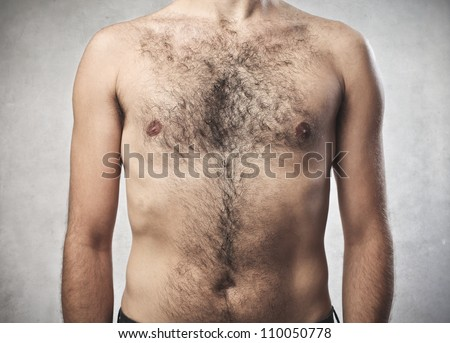 Closeup of a hairy man's chest - stock photo