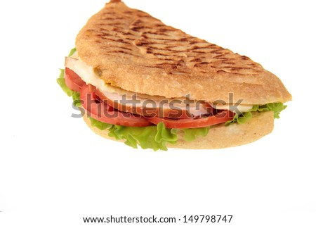 Closeup of a ham salad sandwich isolated against white