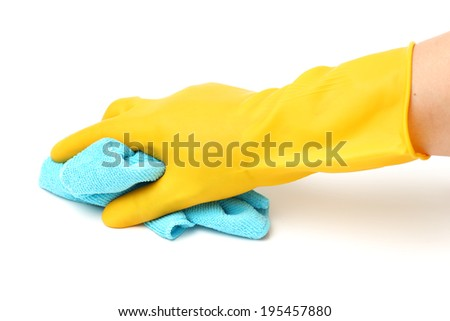 Closeup of a hand in a yellow latex glove using a blue towel to clean a counter top.