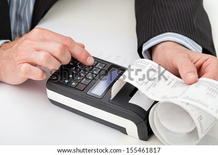 Closeup of a hands counting on a cash register