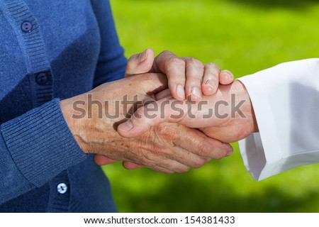 Closeup of a handshake - doctor and a patient