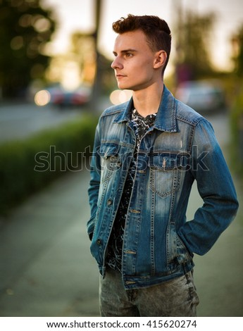 Closeup of a handsome teenage boy in urban environment - stock photo