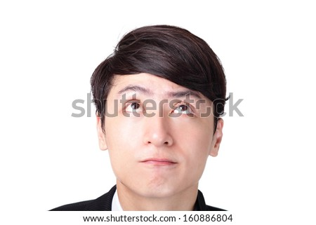 Closeup of a handsome young business man thinking against white background, asian male - stock photo