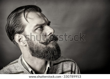 Closeup of a handsome young man with retro look over gray background