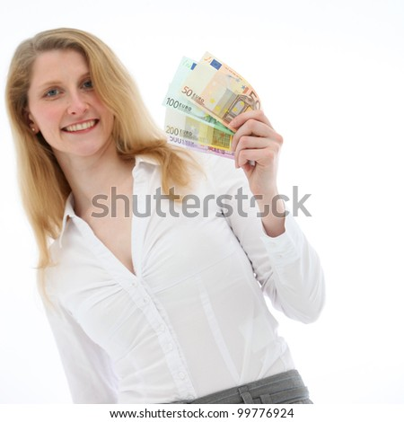 Closeup of a happy blonde woman holding a handful of fanned Euro notes of different values isolated on white