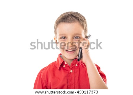 Closeup of a happy little boy speaking on his smartphone over white background