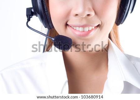 Closeup of a  happy smiling female customer service representative - stock photo