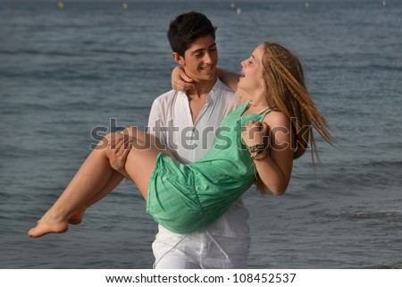 Closeup of a happy young couple together on the beach
