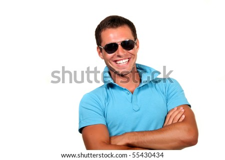 Closeup of a happy young man looking at camera - stock photo