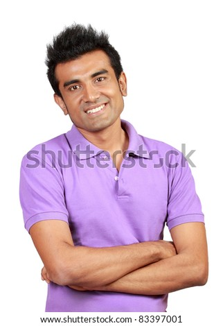 Closeup of a happy young man looking at camera smiling - stock photo