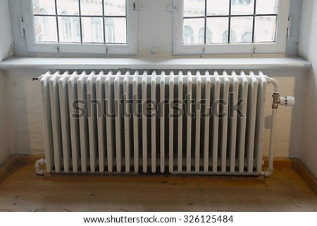 Closeup of a heating radiator - stock photo