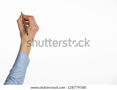 Closeup of a human hand writing with pen isolated on white; copy space