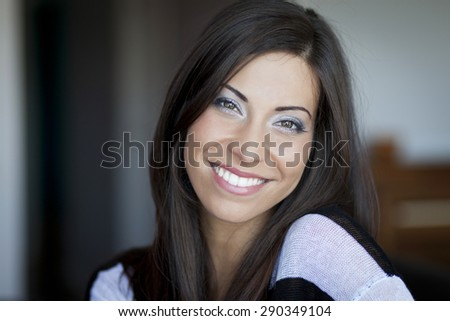 Closeup Of A Italian Woman Smiling At The Camera - stock photo