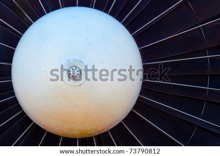 Closeup of a jet turbine engine - stock photo