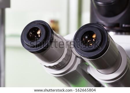 Closeup of a laboratory microscope, eyepiece - stock photo
