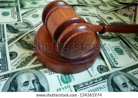closeup of a legal gavel on US cash - stock photo